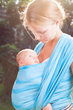 Mother with newborn baby in sling Stock Photo