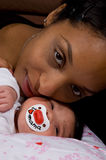 Mother and newborn child. Loving eachother stock photo