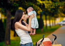 Mother with newborn in the park Royalty Free Stock Photos