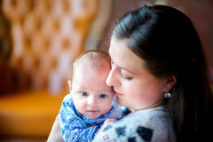 Mother with the newborn son. Mother carefully holds on hands of the newborn son, gently embraces. Happy family. Motherhood Royalty Free Stock Photos