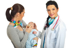 Mother with newborn visit doctor Royalty Free Stock Images