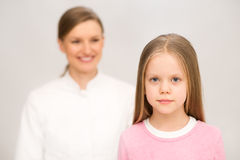 Mother and nurse examining little daughter. Isolat Royalty Free Stock Image
