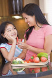 Mother Offering Daughter A Piece Chopped Pepper Royalty Free Stock Photo