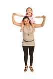 Mother offering piggyback to his girl stock image