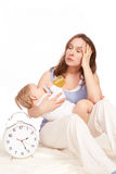 Mother overtired. Young Mother and pretty child stock image