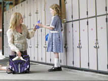 Mother Packing Daughter's School Bag Royalty Free Stock Image