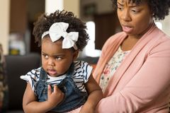 Mother parenting her young child. African American mother disdisciplin parenting her young child royalty free stock photo