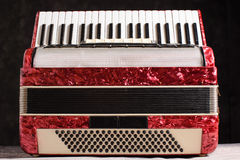 Mother of pearl accordion on a black background.  Royalty Free Stock Image