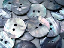 Mother-of-pearl background. Buttons Stock Photography