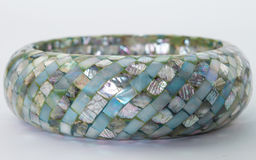 Mother of pearl bangle  on white Royalty Free Stock Image