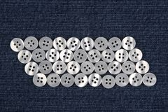 Mother of pearl buttons in blue denim Stock Photo