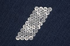 Mother of pearl buttons in blue denim Stock Image