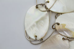 Mother of pearl disks on chain. Close up of mother of pearl disk and chain necklace Stock Photo