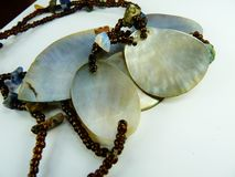 Mother of pearl handmade necklace. Mother of pearl necklace beaded royalty free stock photos