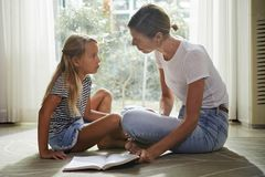Mother and daughter reading together royalty free stock photos