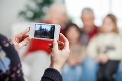 Mother Photographing Family Through Smartphone Royalty Free Stock Photo