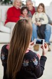Mother Photographing Family Through Smartphone Royalty Free Stock Photography