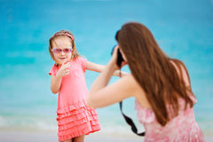 Mother photographing her daughter Royalty Free Stock Photos