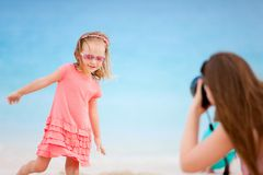 Mother photographing her daughter Royalty Free Stock Photography