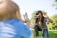 Mother Photographing Son Through Camera Stock Photography