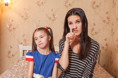 Mother picking a nose against her daughter. Mother picking a nose against her pretty daughter Royalty Free Stock Photography
