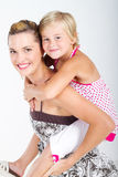 Mother piggyback daughter Royalty Free Stock Photo