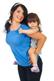 Mother piggyback toddler daughter Stock Photography
