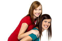 Mother piggybacks her teenage girl Stock Image
