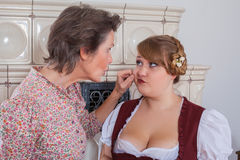 Mother pinches your daughter in the jaw Royalty Free Stock Photos