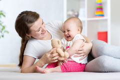 Mother plaing with her daughter baby Stock Photography