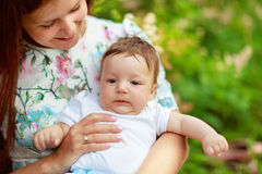Mother play with baby son summer Stock Image