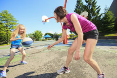 Mother play basketball with his daughter Royalty Free Stock Photo