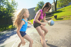 Mother play basketball with his daughter. A mother play basketball with his daughter Stock Photo