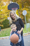 Mother play basketball with his son. A mother play basketball with his son Stock Photography