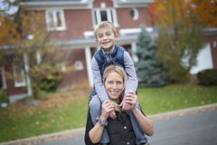 Mother play basketball with his son. A mother play basketball with his son Royalty Free Stock Photos