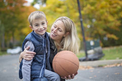 Mother play basketball with his son. A mother play basketball with his son Stock Image