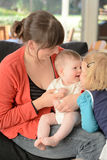 Mother play with her baby and child Royalty Free Stock Photo