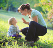 Mother play with her baby outdoor. Happy mother play with her baby outdoor royalty free stock images