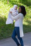 Mother play with infant daughter. Mother at walk play with infant baby girl Stock Images