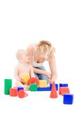 Mother play with little daughter on playground Royalty Free Stock Photos