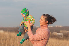 Mother play with smile son. Outdoors royalty free stock photos