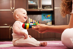 Mother playing with baby Royalty Free Stock Image