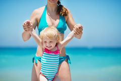 Mother playing with baby on beach Royalty Free Stock Photo