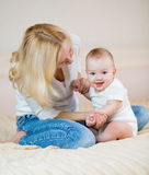 Mother playing with  baby boy indoors Stock Photography