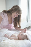 Mother Playing With Baby Boy Stock Photos