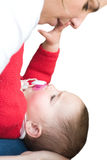 Mother playing with baby daughter Royalty Free Stock Images