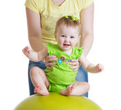 Mother playing with baby on fit ball Stock Image
