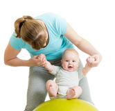 Mother playing with baby on fitness ball. Mother playing with baby on gymnastic ball Royalty Free Stock Photography