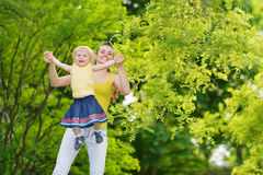 Mother playing with baby girl outdoors Royalty Free Stock Photos