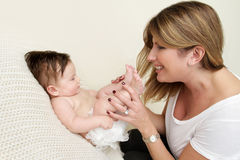 Mother Playing with Baby Stock Photos